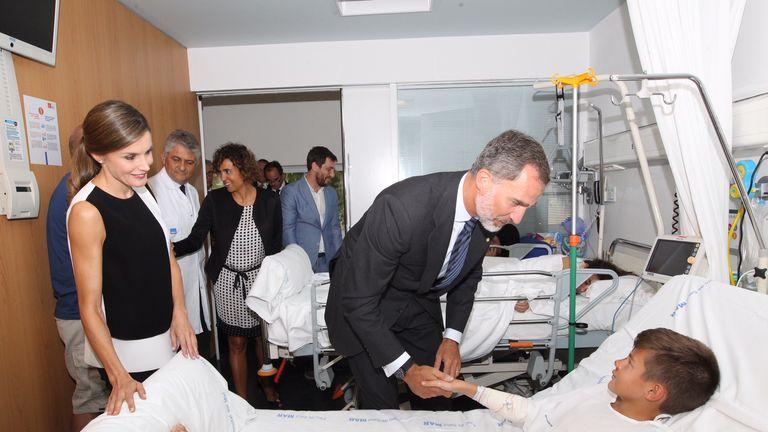In this handout photo provided by Casa de S.M. el Rey de Espana, King Felipe VI of Spain and Queen Letizia of Spain visits a victim of last Thursday's terrorist attack at the Hospital de la Santa Creu i Sant Pau on August 19, 2017 in Barcelona, Spain