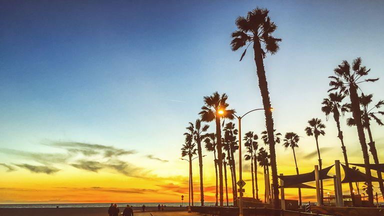People walking along the beach in California