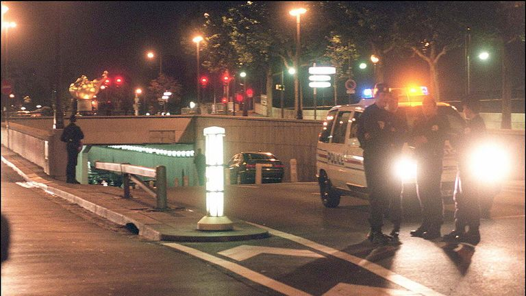 Police guard an entrance of the Alma tunnel in Paris early 31 August
