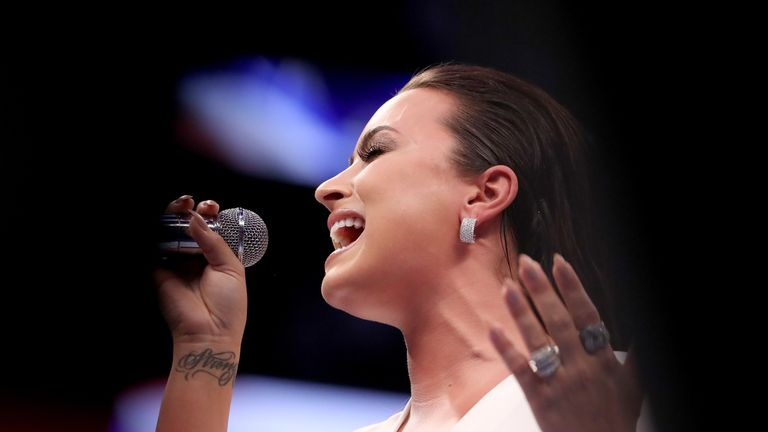 Demi Lovato sings the national anthem, before Mayweather Jr. and McGregor take to the ring
