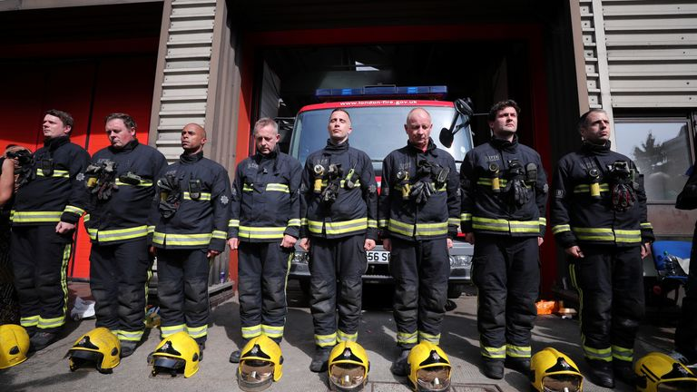 Firefighters line up to take part in the minute's silence