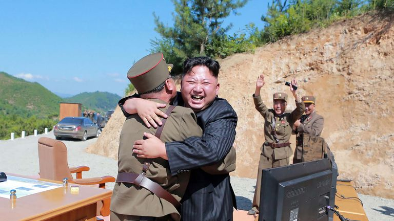 Kim Jong Un celebrates the successful test-fire of the intercontinental ballistic missile Hwasong-14
