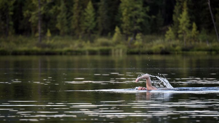 Putin swims during his vacation in the remote Tuva region