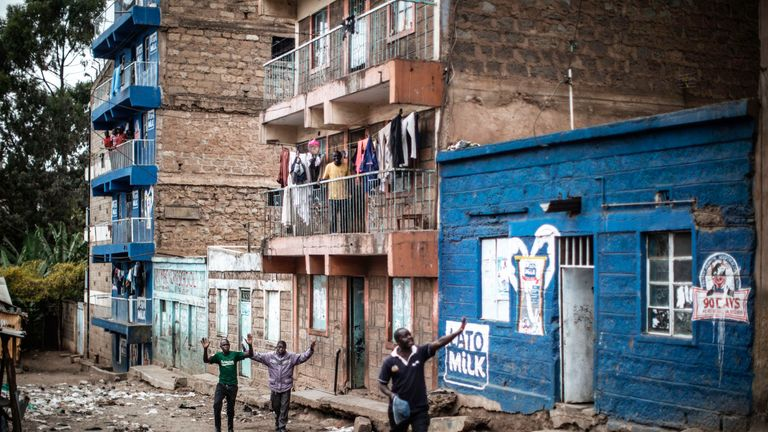 Residents plead with Kenyan security forces as they conduct an operation in Mathare