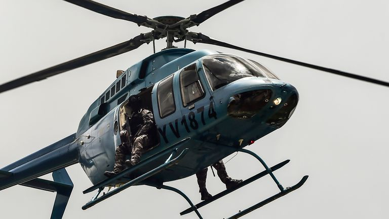 Security forces in helicopter fly over Valencia