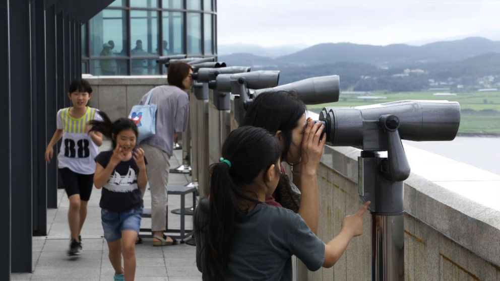 Visitors observe North Korea from the southern side of the Imjin River