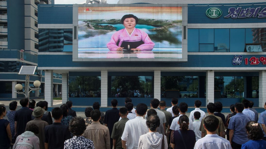 People watch Ri Chun-Hee in Pyongyang as she announces the latest nuclear test