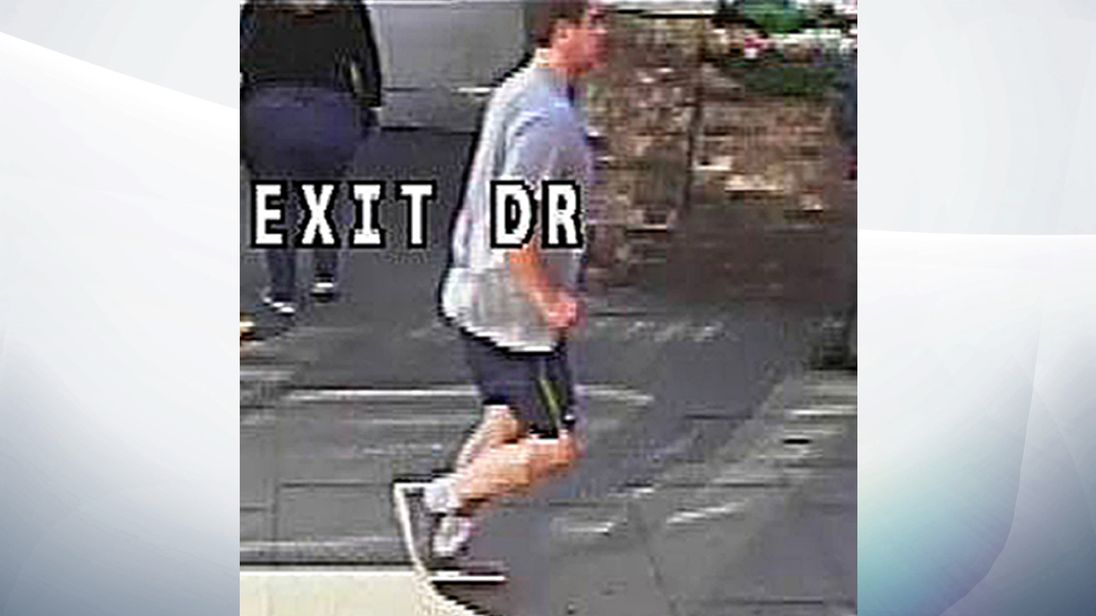CCTV still of a suspect police wish to trace in relation to the assault of a woman who was pushed in front of a London bus by the jogger