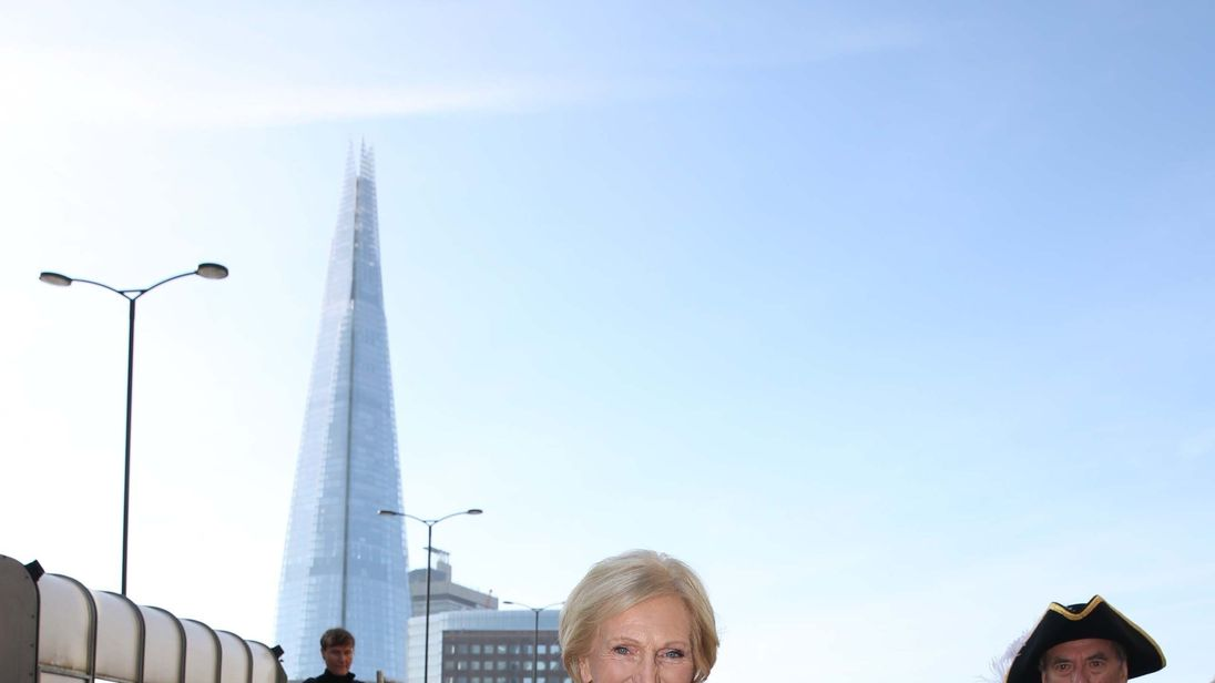 Celebrity baker Mary Berry is followed by new Freemen of the City of London, as she herds sheep over London Bridge to help open the Wool Fair