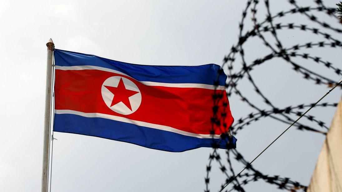 The North Korea flag flutters