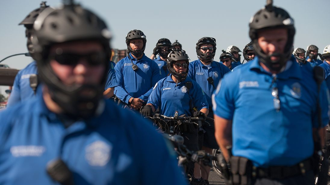 Police block the road as protesters march through St Louis