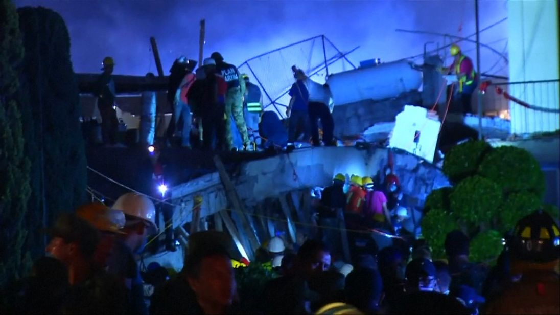 Many children are believed trapped under the rubble of their school