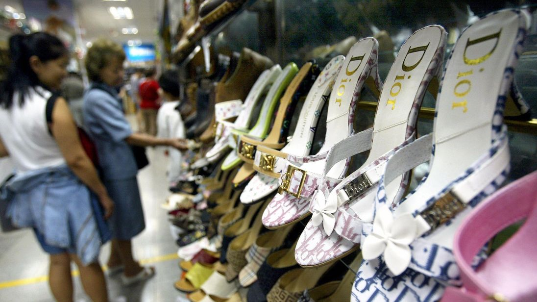 Counterfeit name brand shoes are on display at a Beijing clothing market