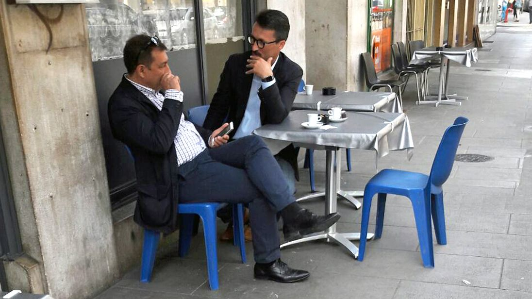 Jose Manuel Costas Estevez pictured with Mark Acklom in a Geneva cafe