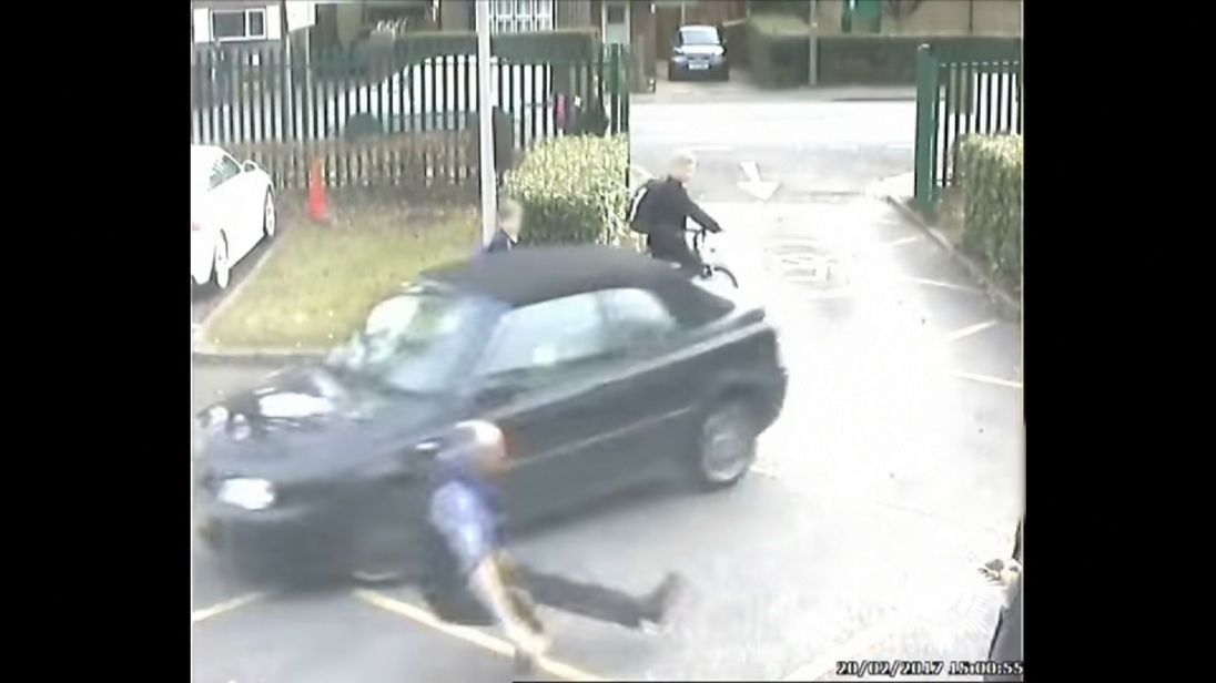 Dad drives into teacher at school gate