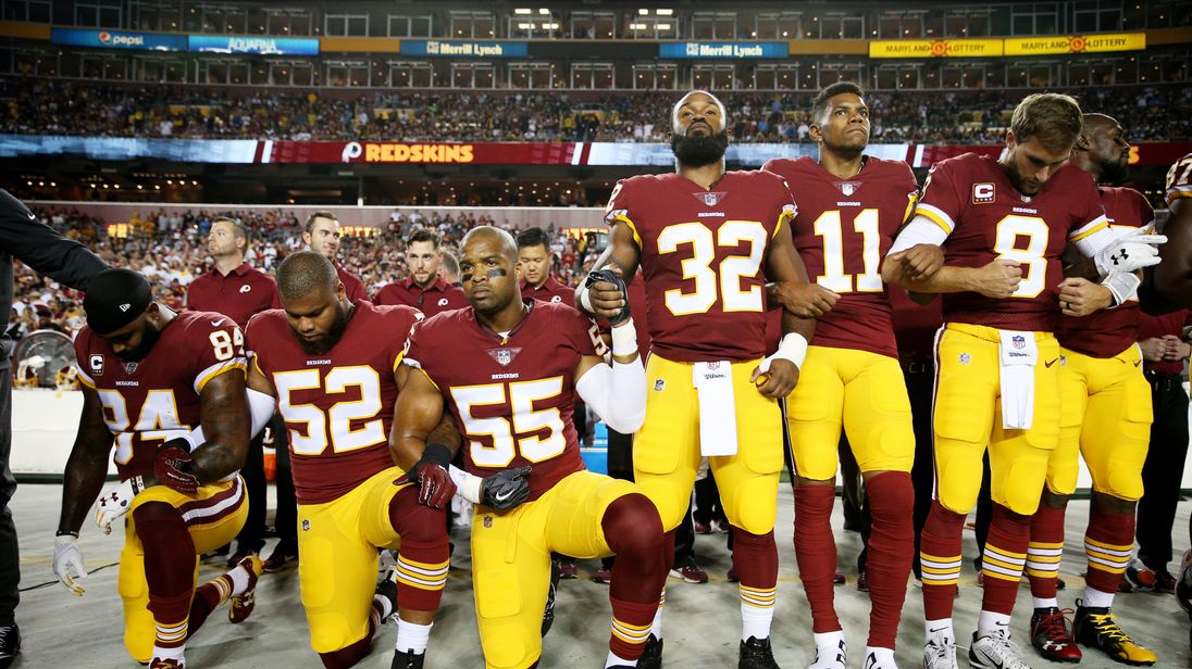 Washington Redskins players kneel during the national anthem