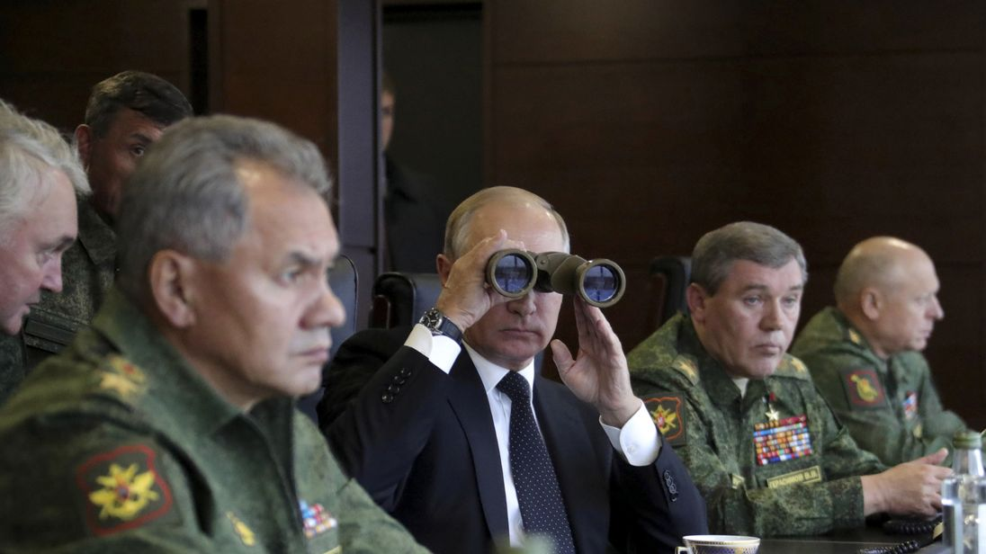 Russian President Vladimir Putin uses a pair of binoculars while watching the Zapad-2017 war games