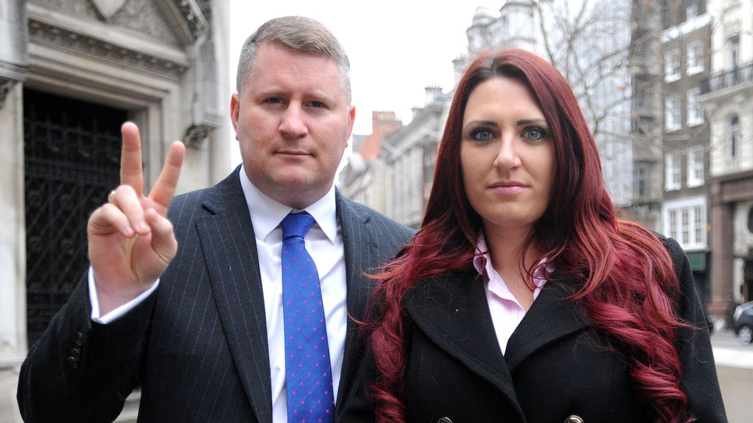 Paul Golding, leader of Britain First, and the party's deputy leader, Jayda Fransen, arrive at the Royal Courts of Justice in central London, where he is appearing in connection with an alleged breach of an injunction, relating to his activities around mosques.
