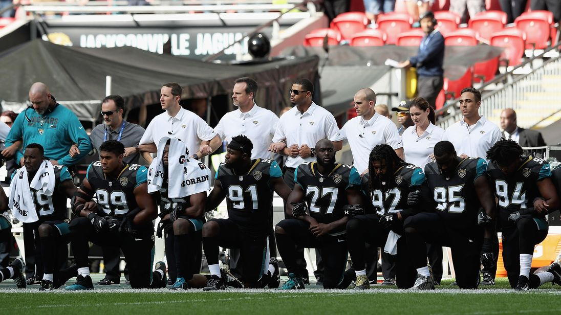 Players from both sides knelt during the US national anthem at Wembley's NFL game