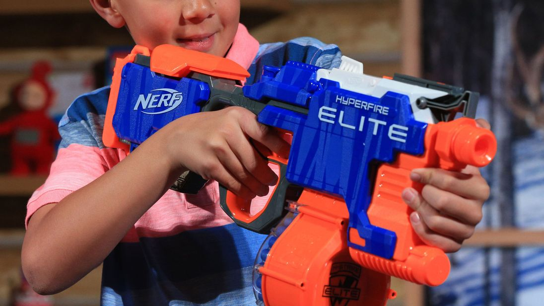 A child prepares to use a Nerf gun
