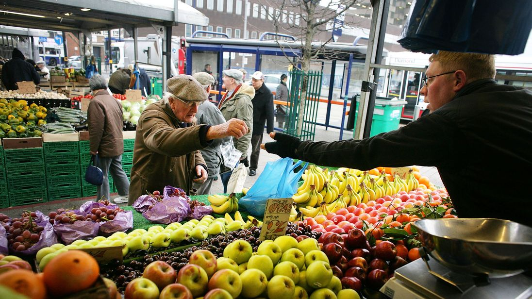 A stall holder sells his fruit and vegetables at the Bull Ring Market in Birmingham