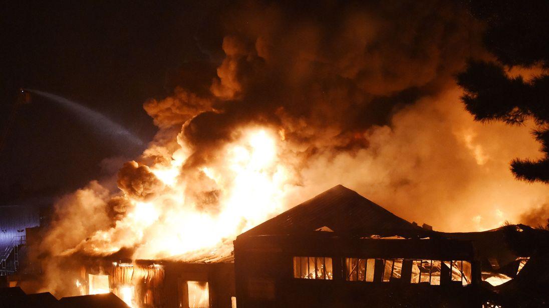 Firefighters battle a warehouse blaze on White Hart Lane in Tottenham, London on September 19, 2017