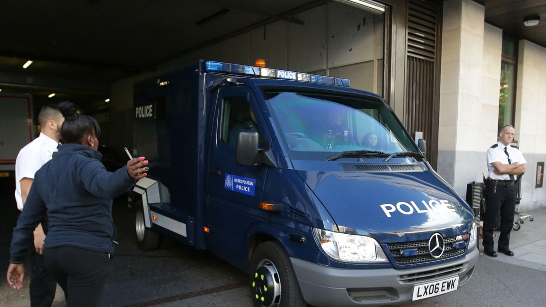 A police van believed to be carrying Ahmed Hassan leaves Westminster Magistrates' Court
