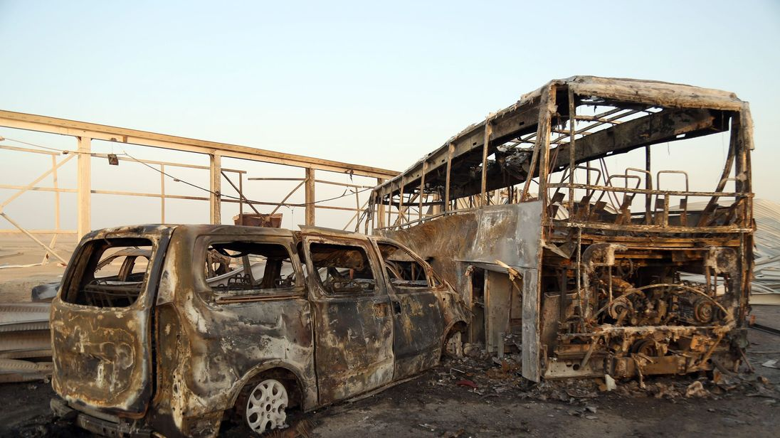 Burnt out vehicles at the scene near the southern Iraqi city of Nasiriyah