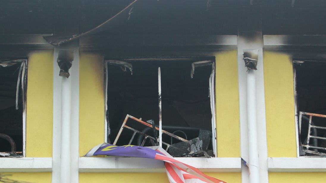 Burnt windows of the Darul Quran Ittifaqiyah religious school in Kuala Lumpur