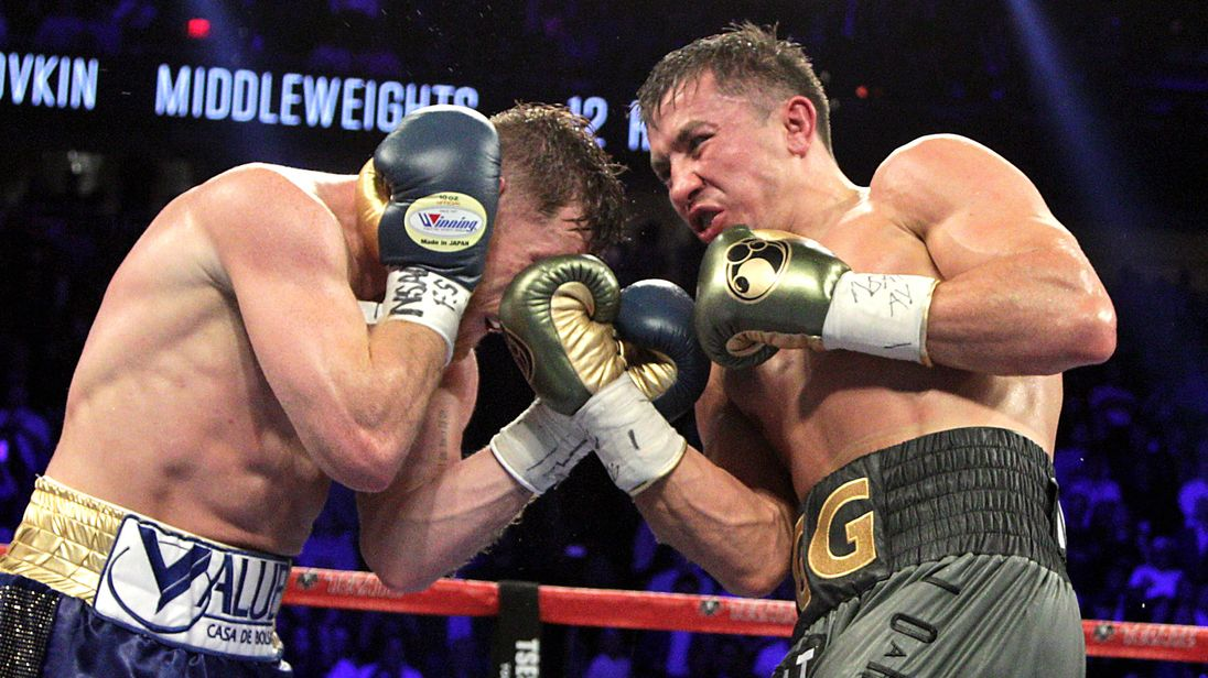 Gennady Golovkin (R) digs a right uppercut against Canelo Alvarez (L) during their WBC, WBA and IBF middleweight championship fight at the T-Mobile Arena o