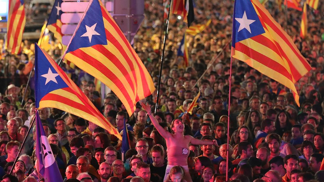 People gathered at a final pro-independence rally in Barcelona on Friday