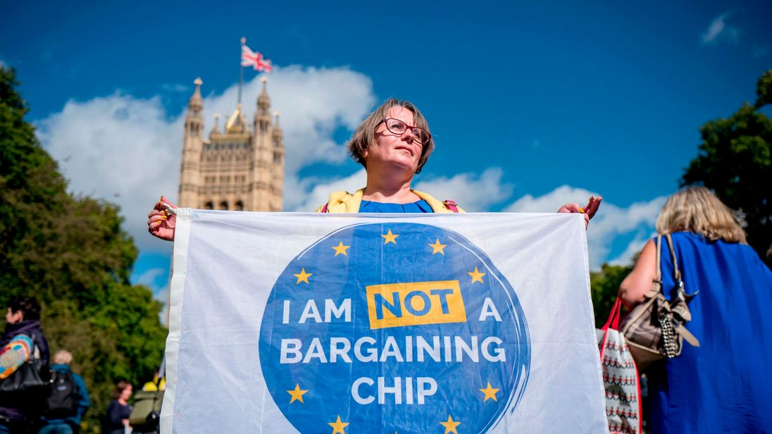 Demonstrators hold banners during a protest to Lobby MPs to guarantee the rights of EU citizens living in the UK, after Brexit, outside the Houses of Parliament in central London on September 13, 2017. After navigating the first hurdle of a key Brexit bill, British Prime Minister Theresa May on Tuesday won another parliamentary vote which will help prevent opposition MPs from blocking future legislation