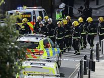 Members of the emergency services work near Parsons Green tube station