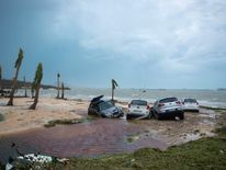 Cars on the beach in Marigot, near the Bay of Nettle, on the French Collectivity of Saint Martin