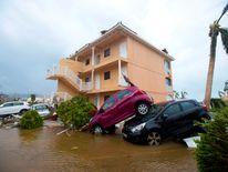 Cars piled on top of one another in Marigot, near the Bay of Nettle, on the French Collectivity of Saint Martin