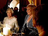 Queen Elizabeth chatting to guests at the ITV 50th Anniversary celebration, including Liz Dawn (centre right)