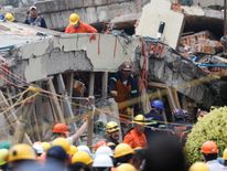 Rescue workers search through the rubble for students at Enrique Rebsamen school