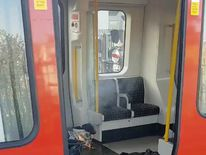 Personal belongings and a bucket with an item on fire inside it on the floor of an underground train carriage. Pic: Sylvain Pennec