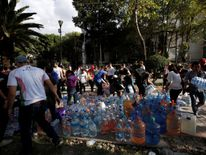 People donate water for rescue workers and victims