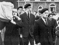 Jan 1973: Gerry Adams (centre) in Belfast, acting as a member of the IRA guard of honour at the funeral of a member who was killed whilst planting a bomb