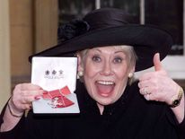Liz Dawn at Buckingham Palace after she received an MBE