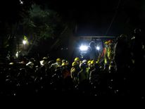 Rescuers and people work at a collapsed building