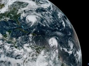 The satellite image shows hurricanes Jose(L) and Maria(R)