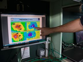 A screen monitors the progression of Hurricane Maria