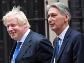 Boris Johnson and Philip Hammond walked out together smiling
