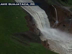 Water spews from Lake Guajataca's dam