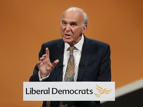 Sir Vince Cable addresses his party's annual conference at the Bournemouth