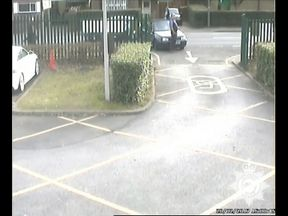 Surrey Police have released dramatic video footage of a parent who drove at a teacher at the school gates.