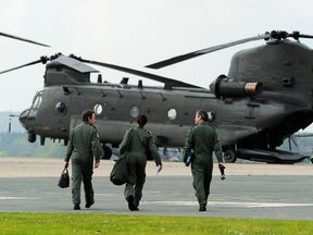 A flight crew at RAF Odiham prepares to take part in a military fly past formation as part of the Diamond Jubilee celebrations