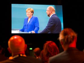 BERLIN, GERMANY - SEPTEMBER 03: Journalists at the Adlershof television studios watch the live broadcast of the television debate between German Chancellor and Christian Democrat (CDU) Angela Merkel and her main opponent, German Social Democrat (SPD) and chancellor candidate Martin Schulz, on September 3, 2017 in Berlin, Germany. Germany will hold federal elections on September 24 and so far Merkel, who is seeking a fourth term, has a double-digit lead over Schulz. (Photo by Omer Messinger/Getty